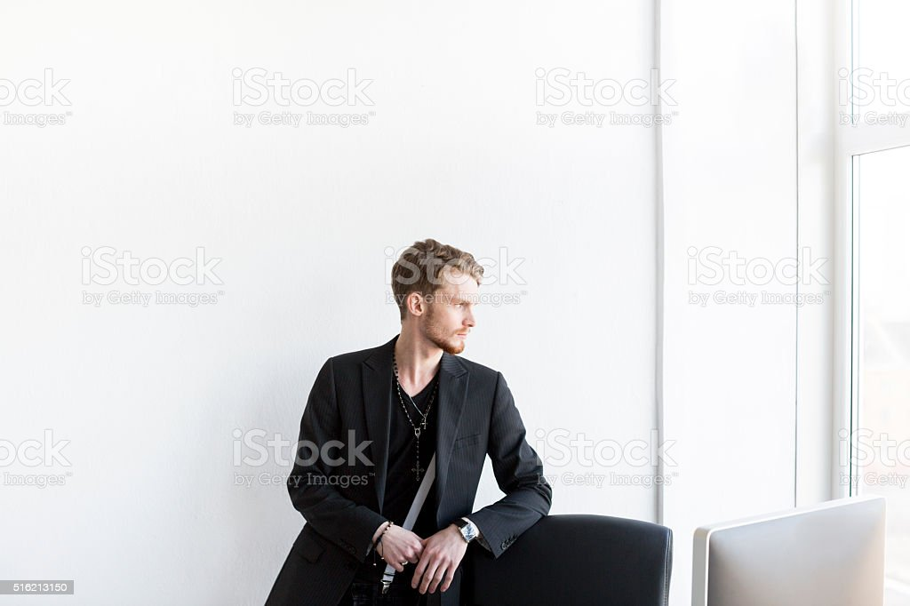 Handsome Elegant Businessman Looking Outside His Office stock photo