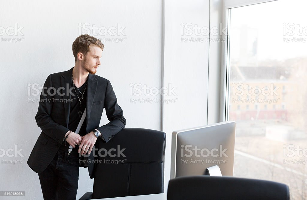Handsome Elegant Office Employee Looking Outside The Window stock photo