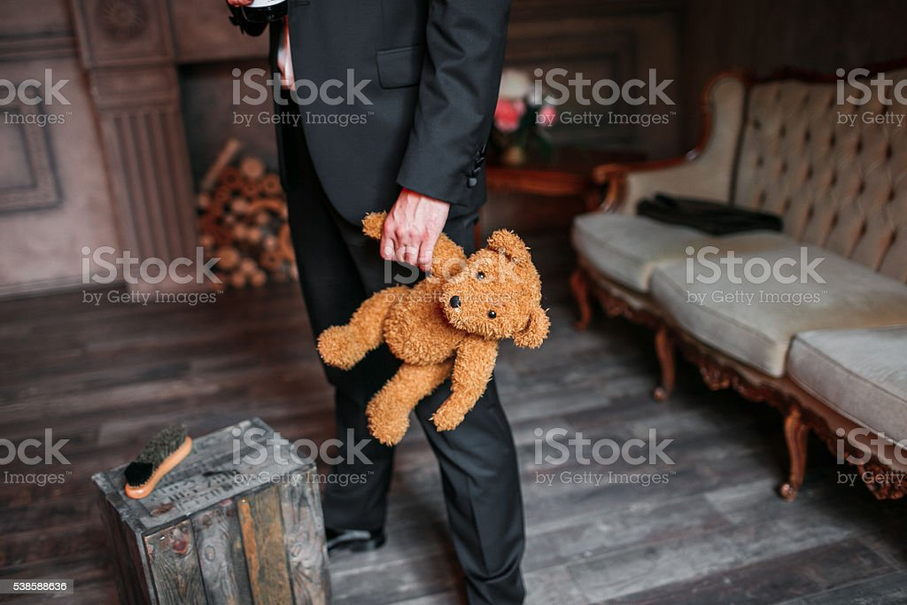 Handsome elegant young fashion man in black classical costume suit stock photo