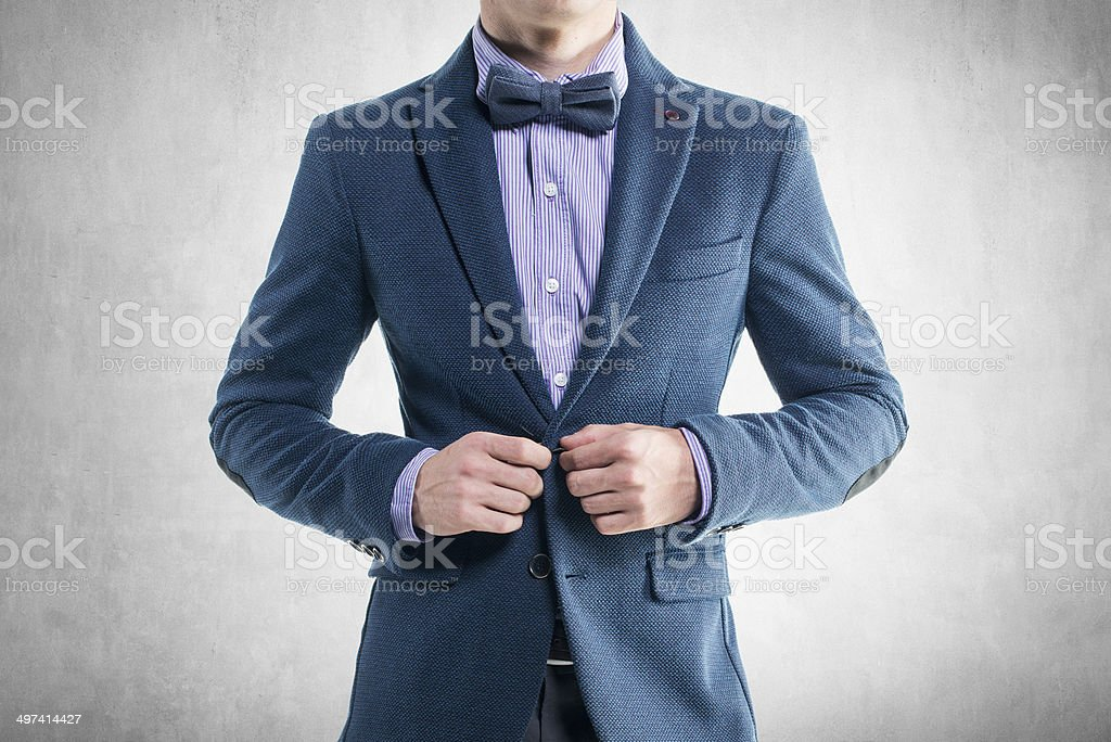 Handsome elegant young fashion man in coat tuxedo classical costume stock photo