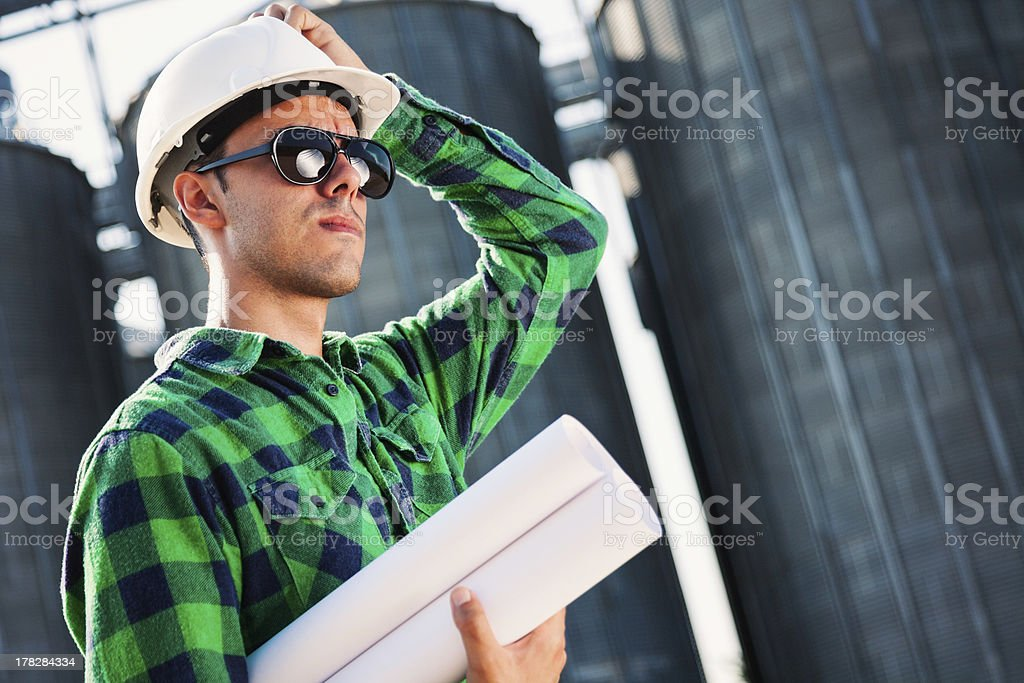 Handsome engineer thinking royalty-free stock photo