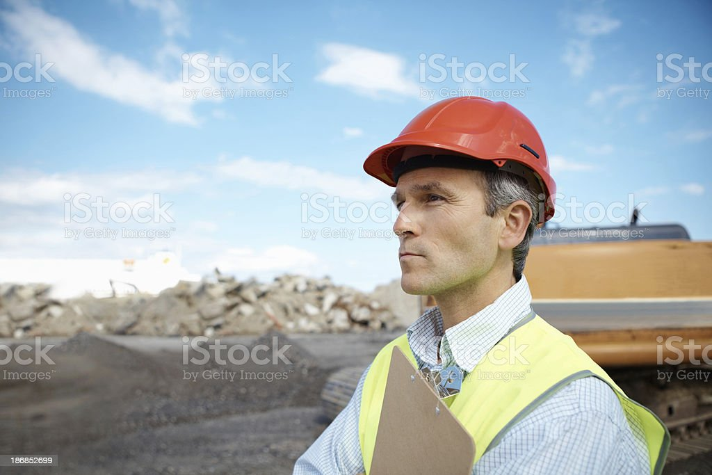 Handsome engineer working at construction site royalty-free stock photo