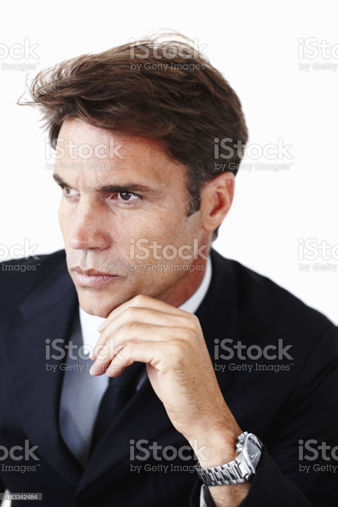 Handsome executive thinking about options royalty-free stock photo