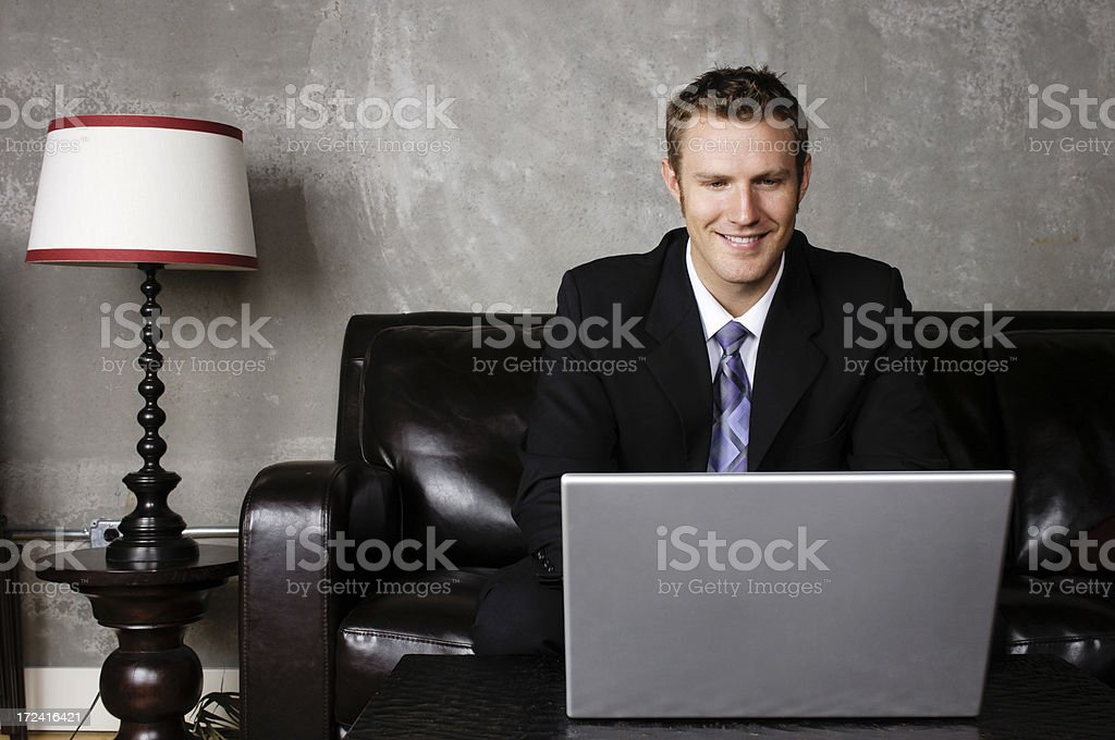 Handsome executive working on his laptop royalty-free stock photo