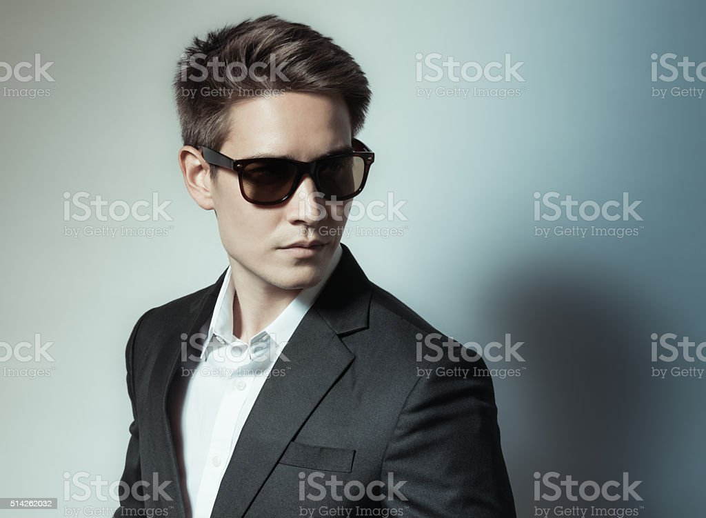 Handsome fashion model in suit stock photo