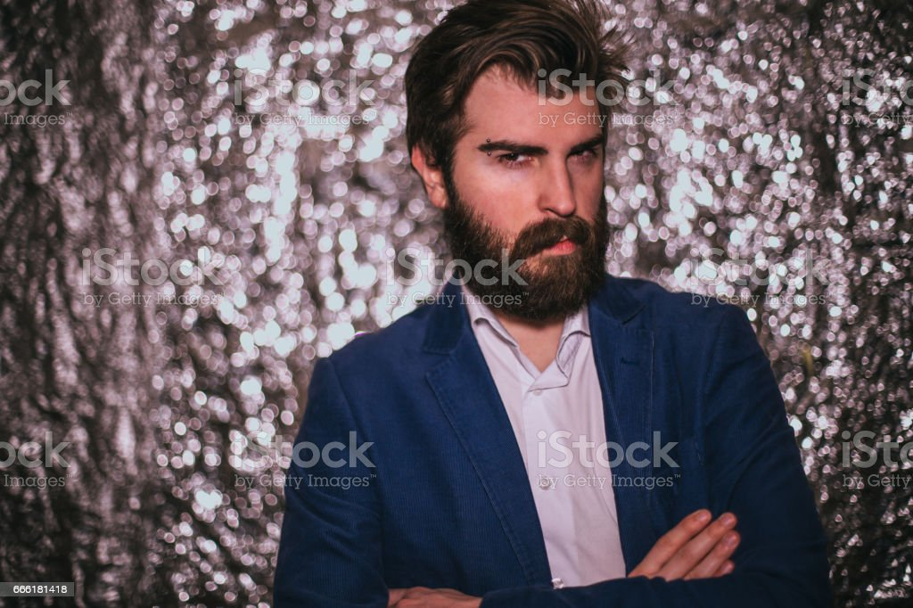 Handsome fashionable bearded man having night out stock photo