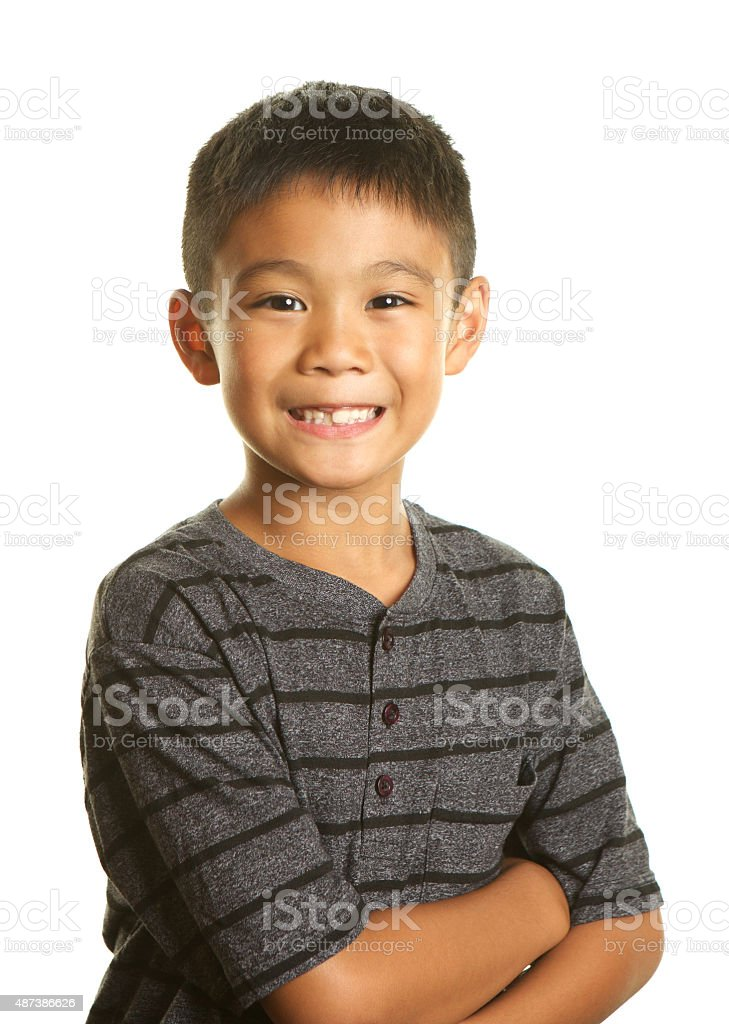 Handsome Filipino Boy Smiling on White Background stock photo