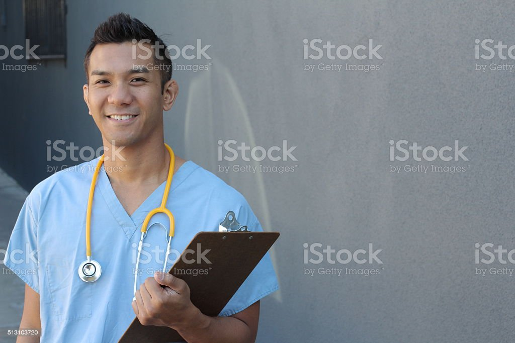Handsome Filipino healthcare professional smiling stock photo