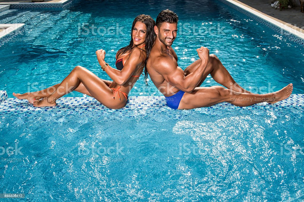 Handsome Fit Couple at the Swimming Pool stock photo