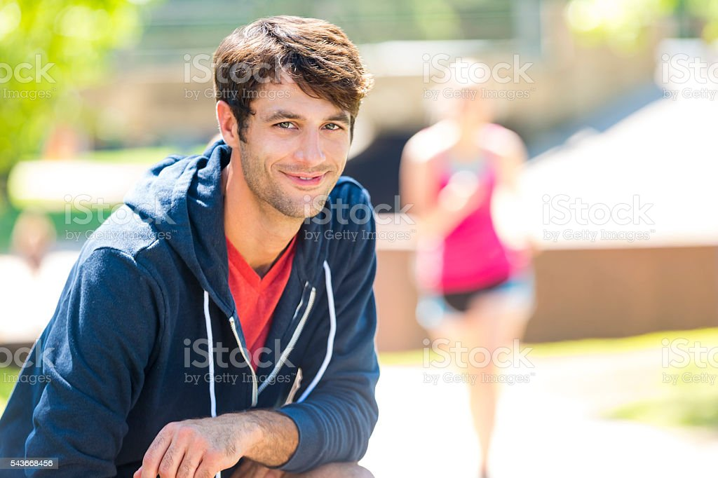 Handsome fitness caucasian man in a park stock photo