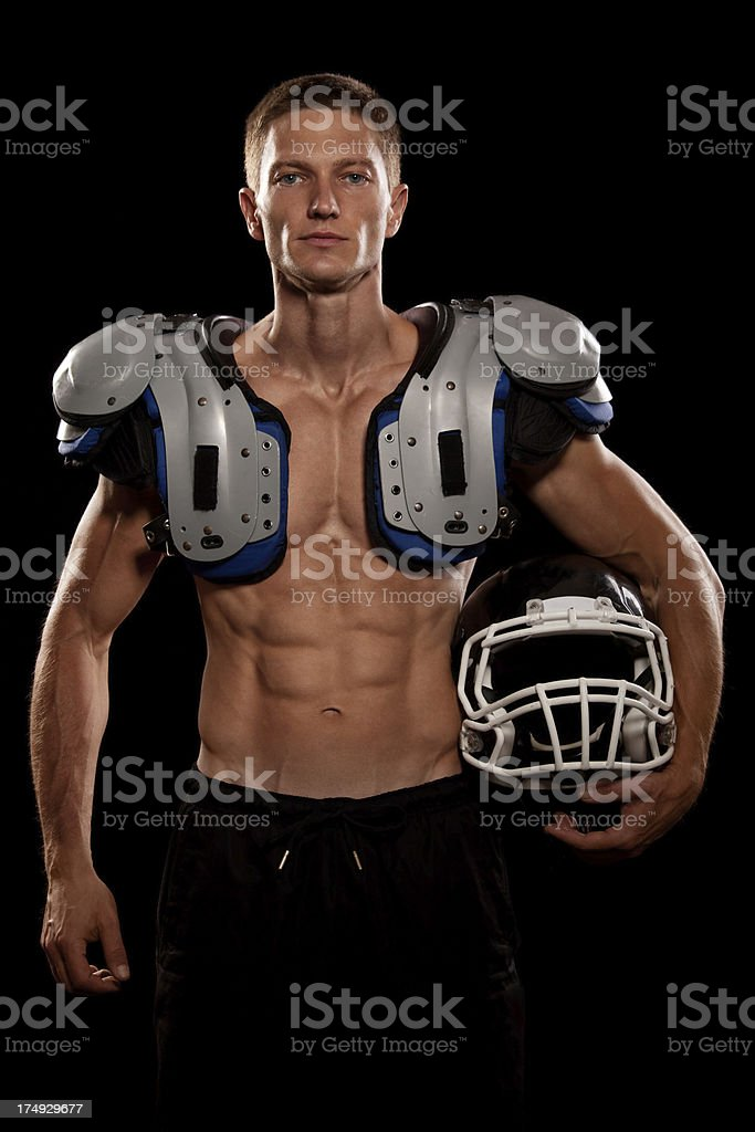 Handsome football player with equipment stock photo