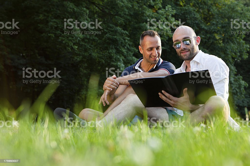 handsome gay couple relax in a park royalty-free stock photo
