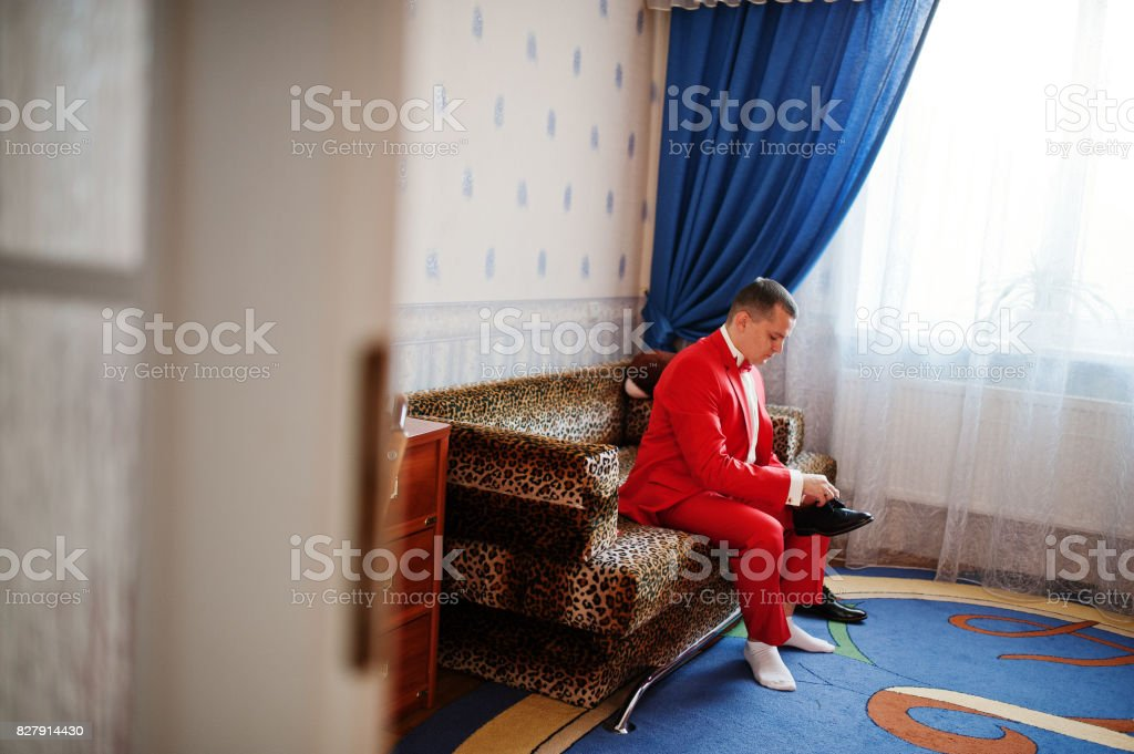 Handsome groom dressing up and getting ready for his wedding ceremony. stock photo
