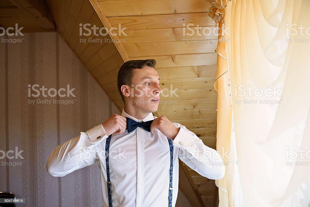 Handsome groom getting ready for the wedding ceremony. stock photo