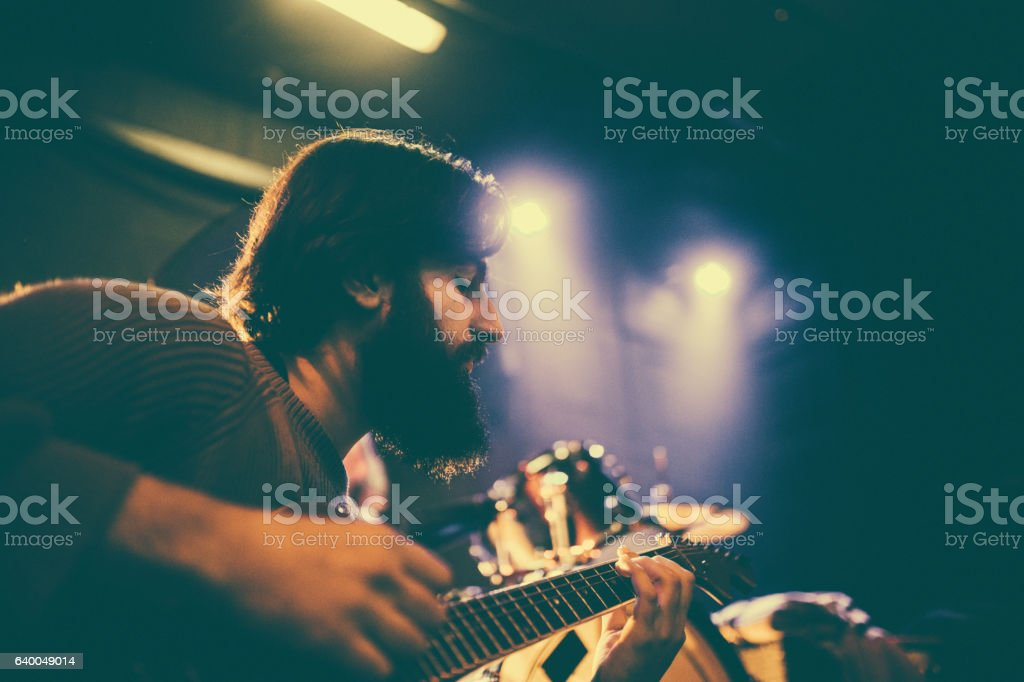 Handsome guitar player stock photo