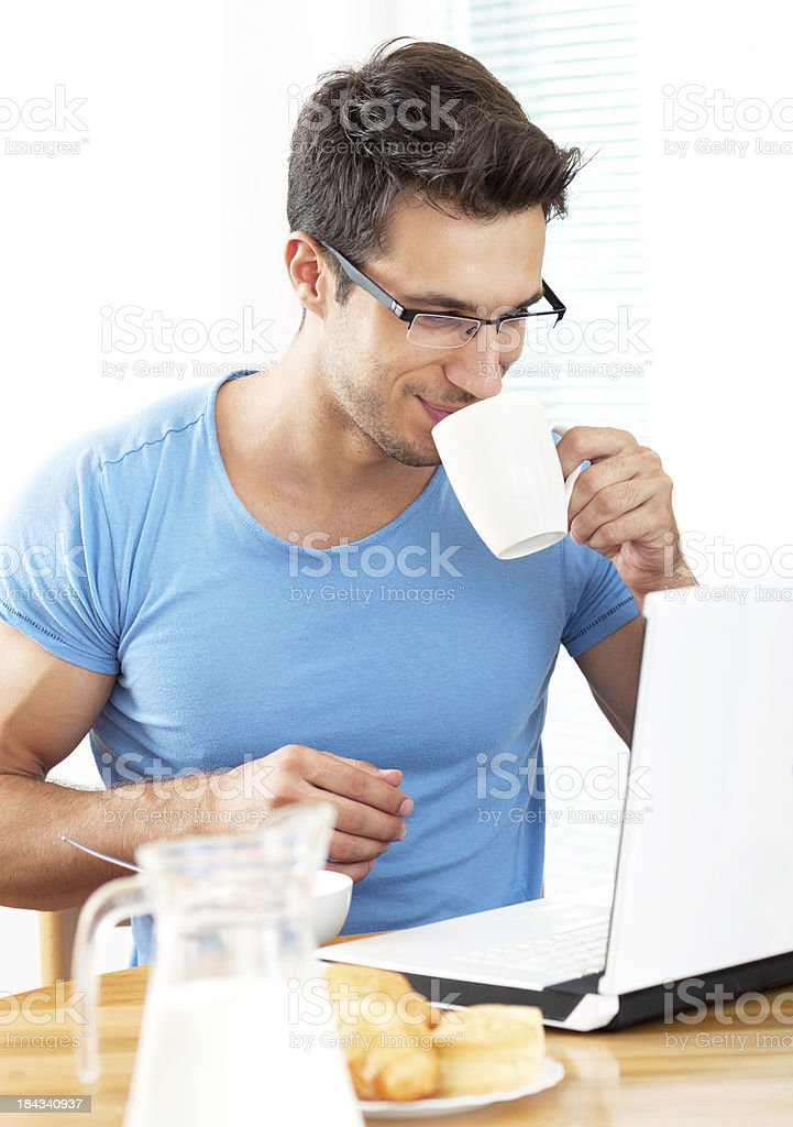 handsome guy having breakfast royalty-free stock photo
