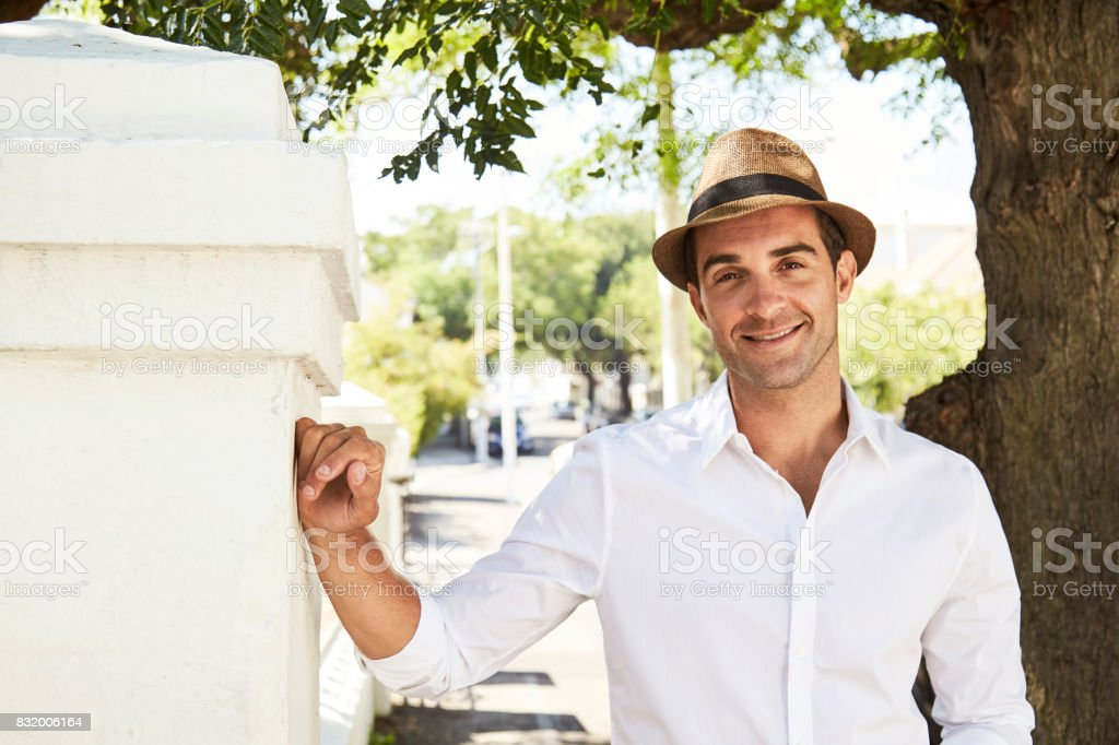 Handsome guy in hat stock photo