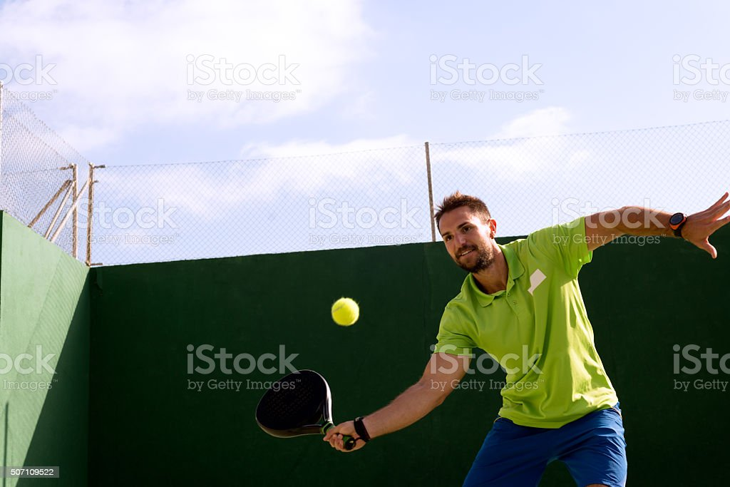 Handsome Guy playing Tennis stock photo