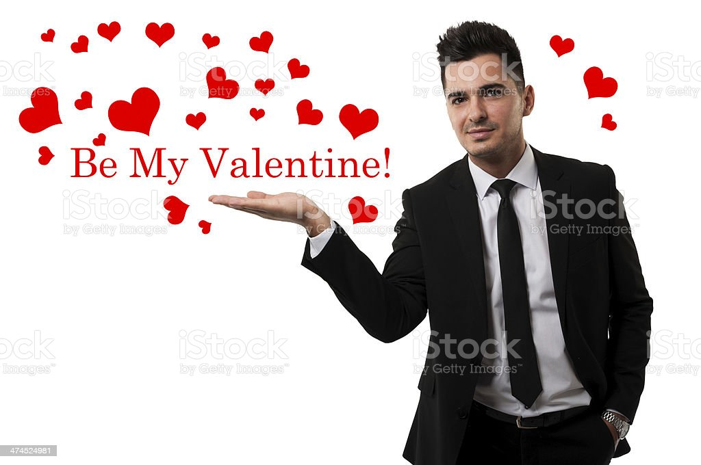 Handsome guy sending love in the shape of red hearts royalty-free stock photo