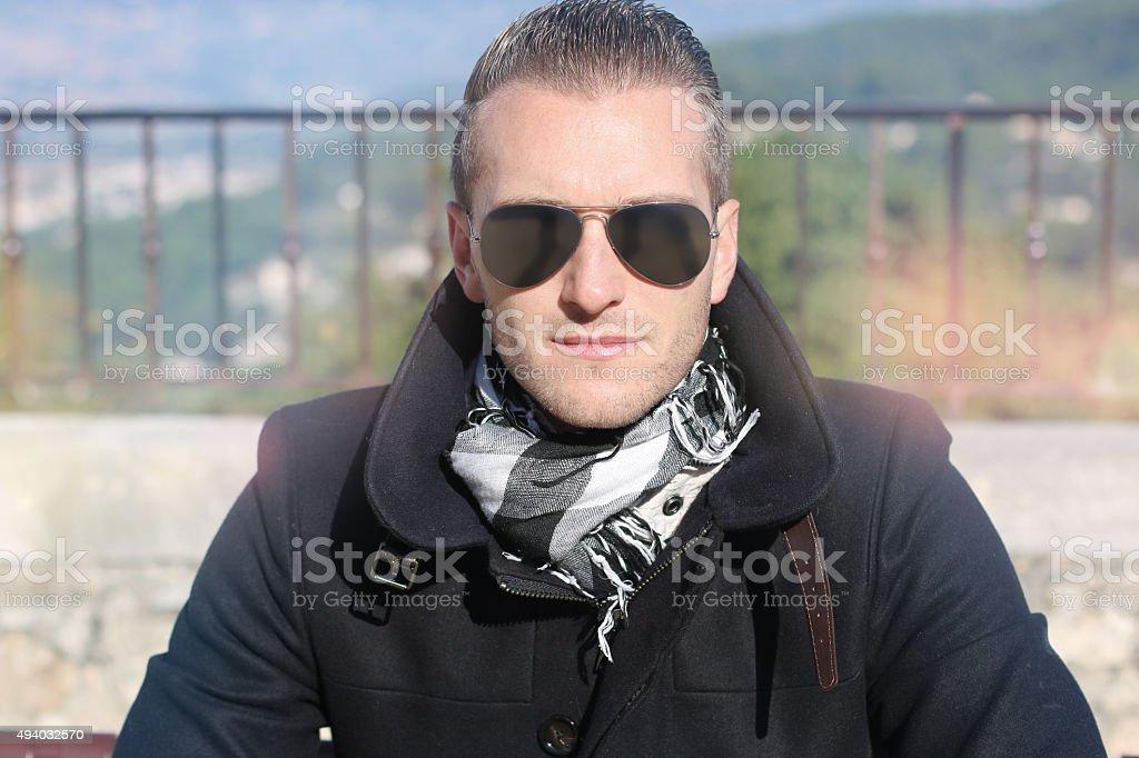 handsome guy wearing aviator glasses stock photo