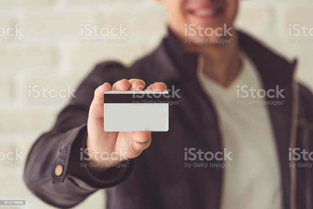 Handsome guy with credit card stock photo