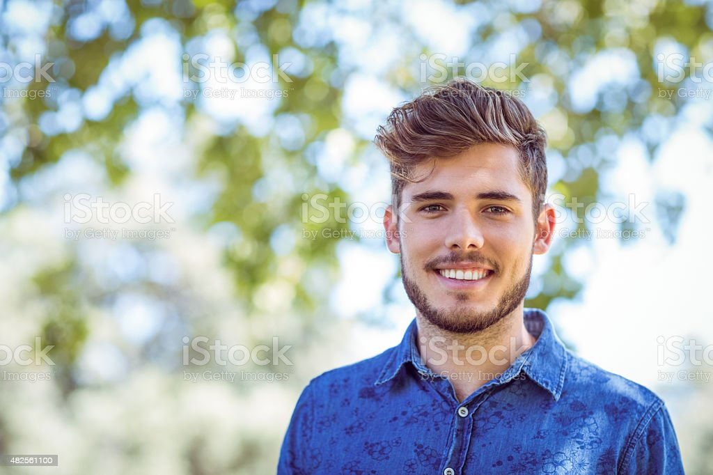 Handsome hipster looking at camera stock photo