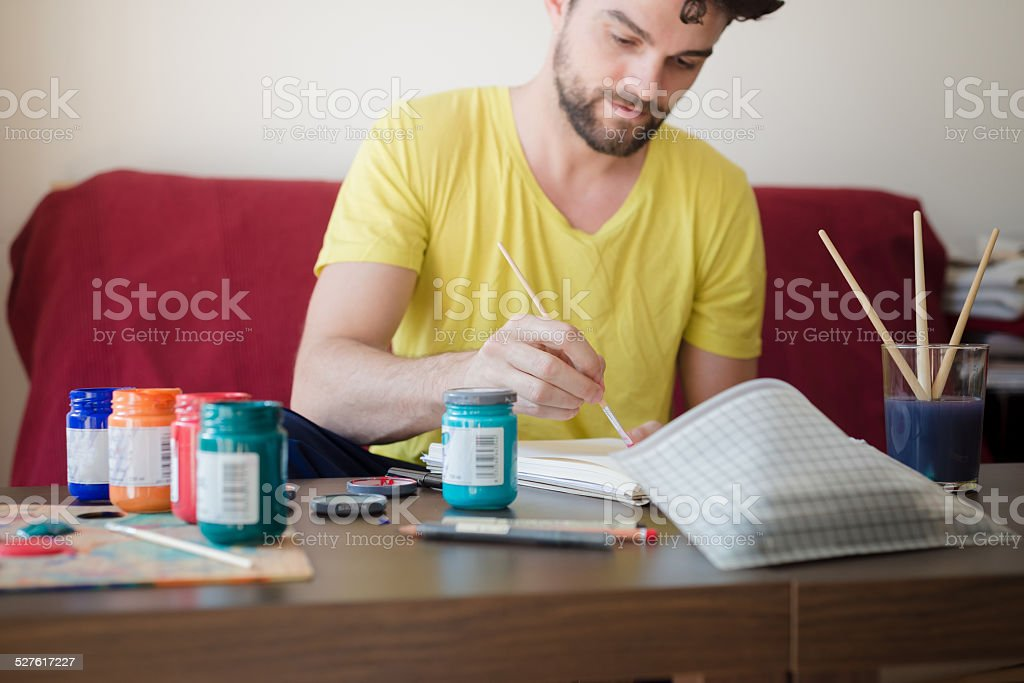 handsome hipster modern man painting stock photo