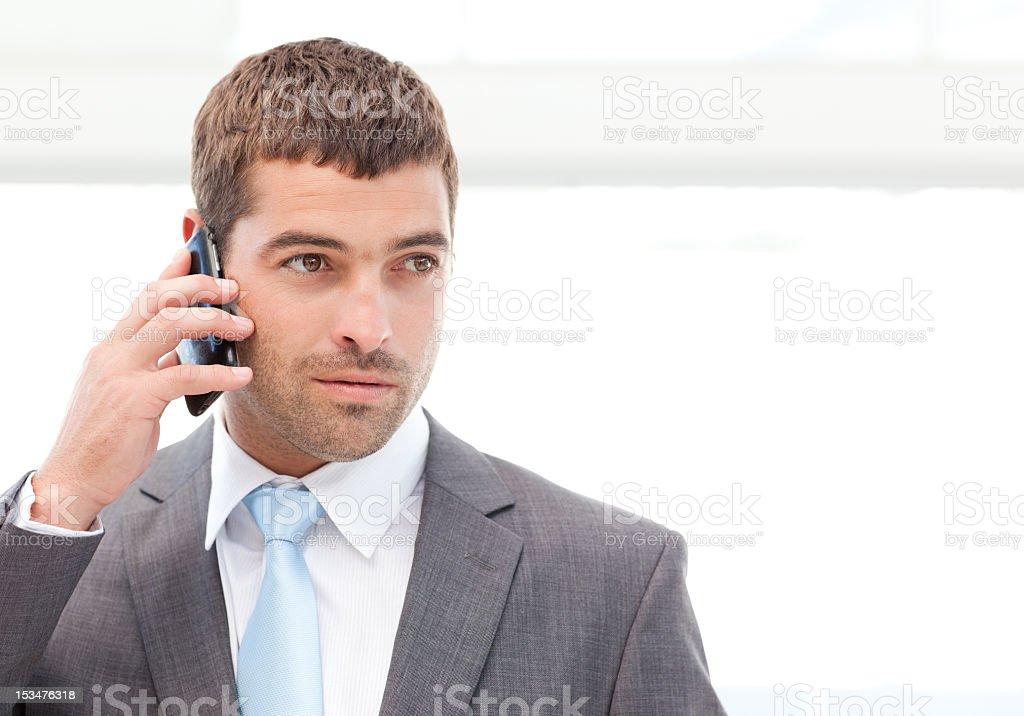 Handsome hispanic businessman on the phone royalty-free stock photo