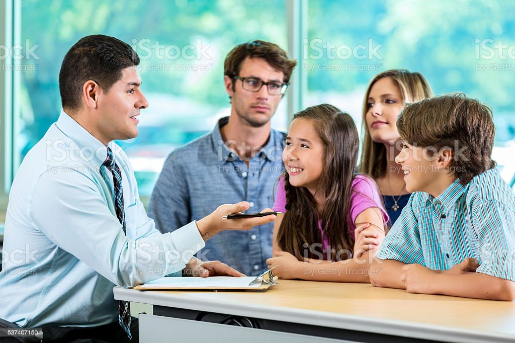 Handsome Hispanic Consultant with Client Family stock photo