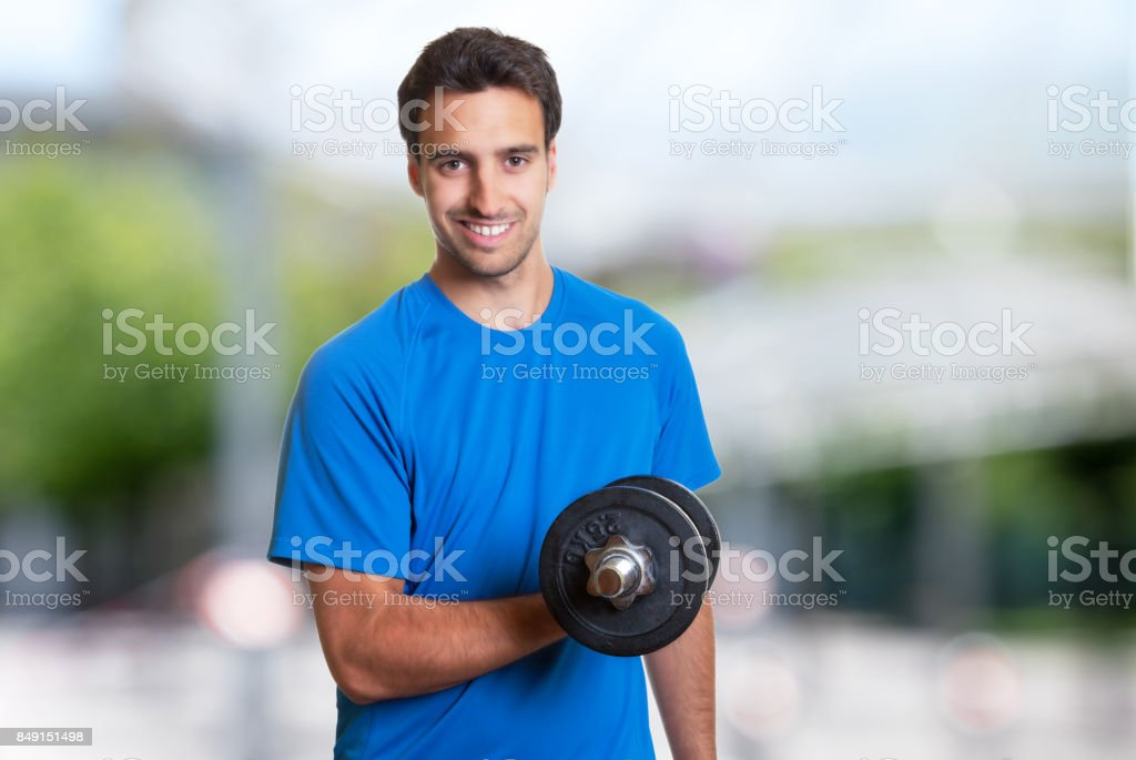 Handsome hispanic man at workout stock photo