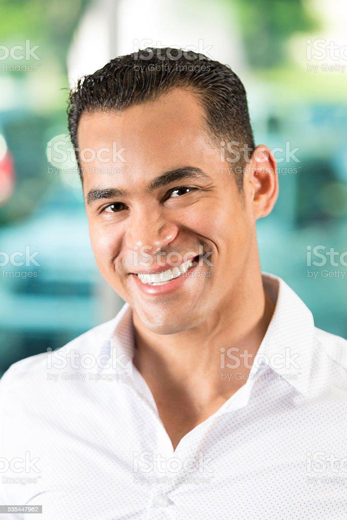 Handsome Hispanic Man smiling stock photo