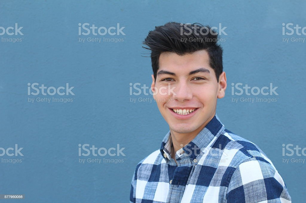 Handsome hispanic man with a perfect white smile stock photo