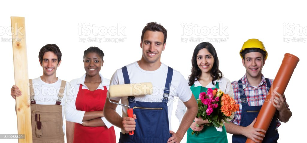 Handsome hispanic painter with group of other international apprentices stock photo