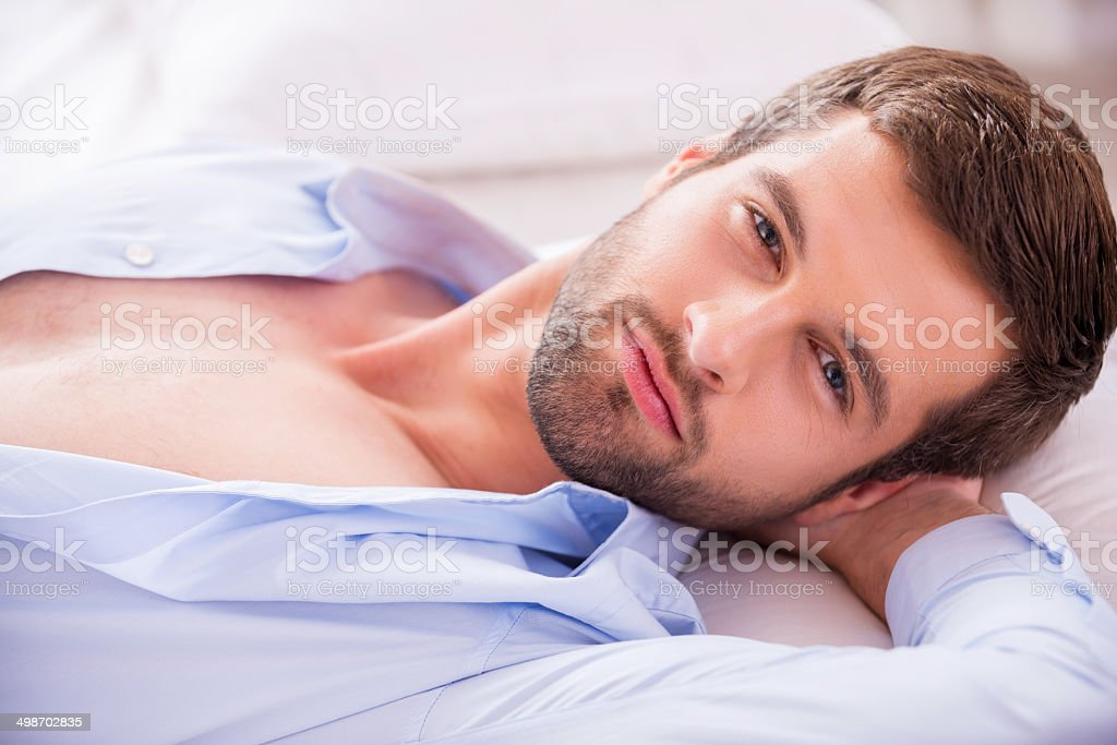 Handsome in bed. stock photo