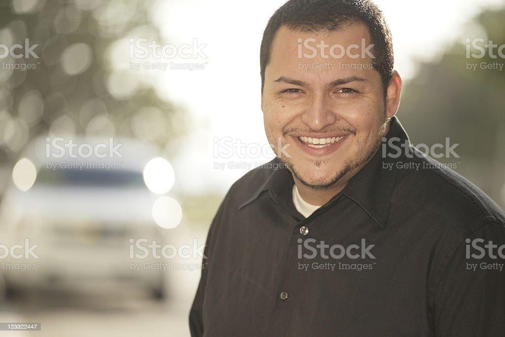 Handsome Latino smiling stock photo