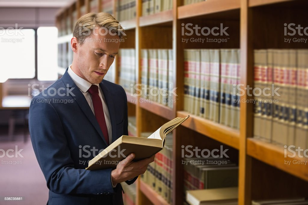 Handsome lawyer in the law library stock photo