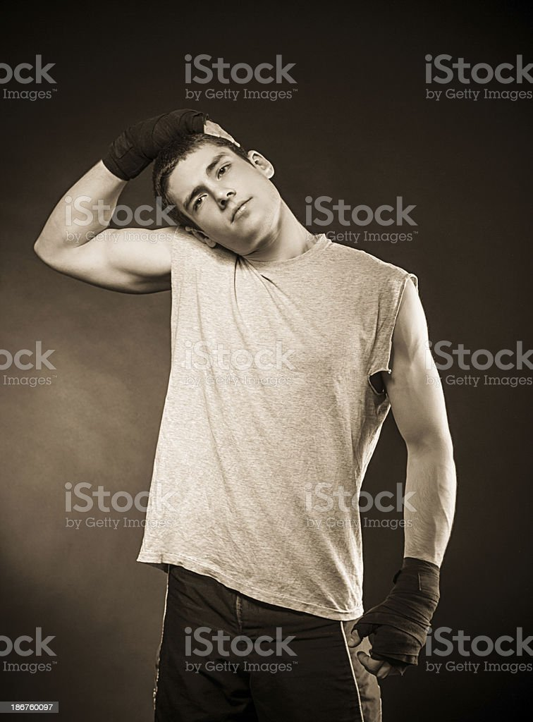 Handsome male boxer with bandages, stretching royalty-free stock photo