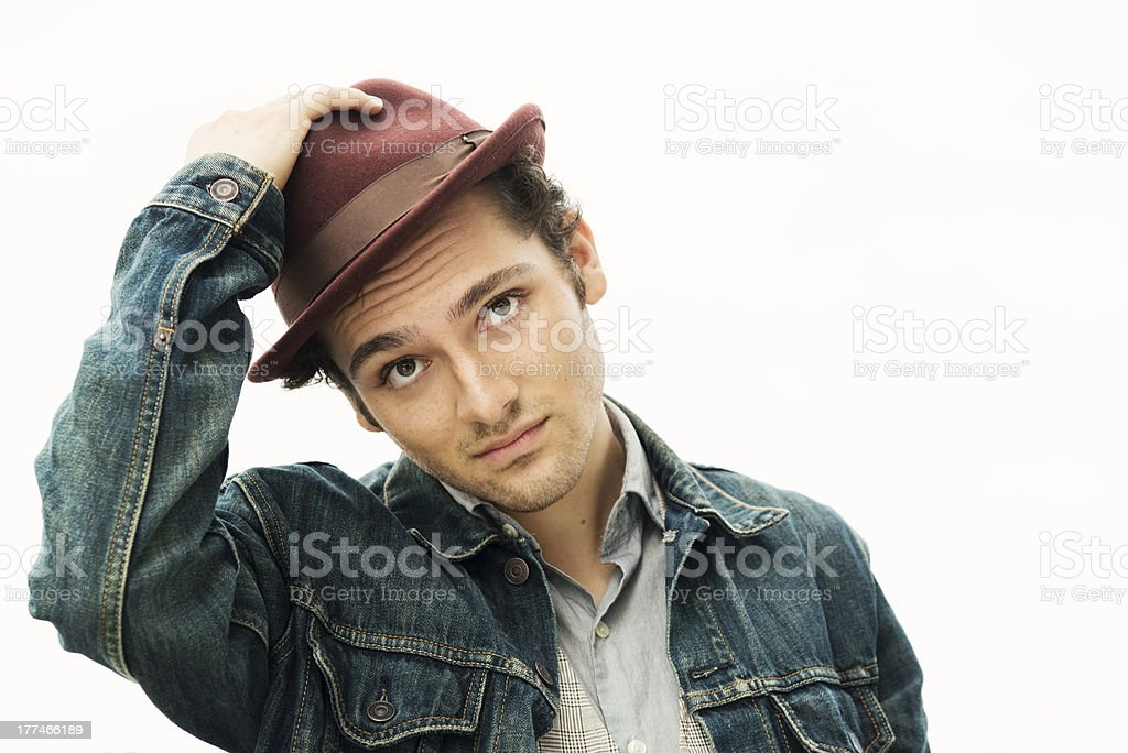 Handsome Male College Student Tipping His Hat stock photo
