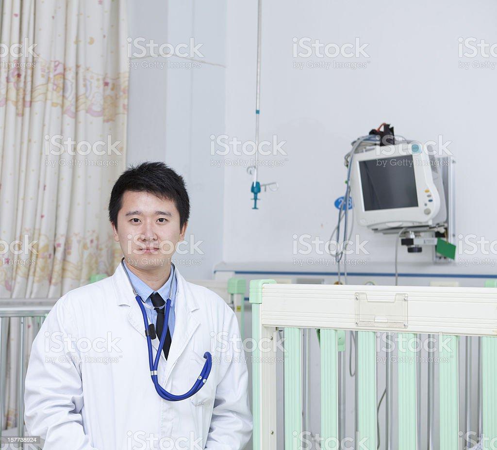Handsome Male Doctor in children's ward stock photo