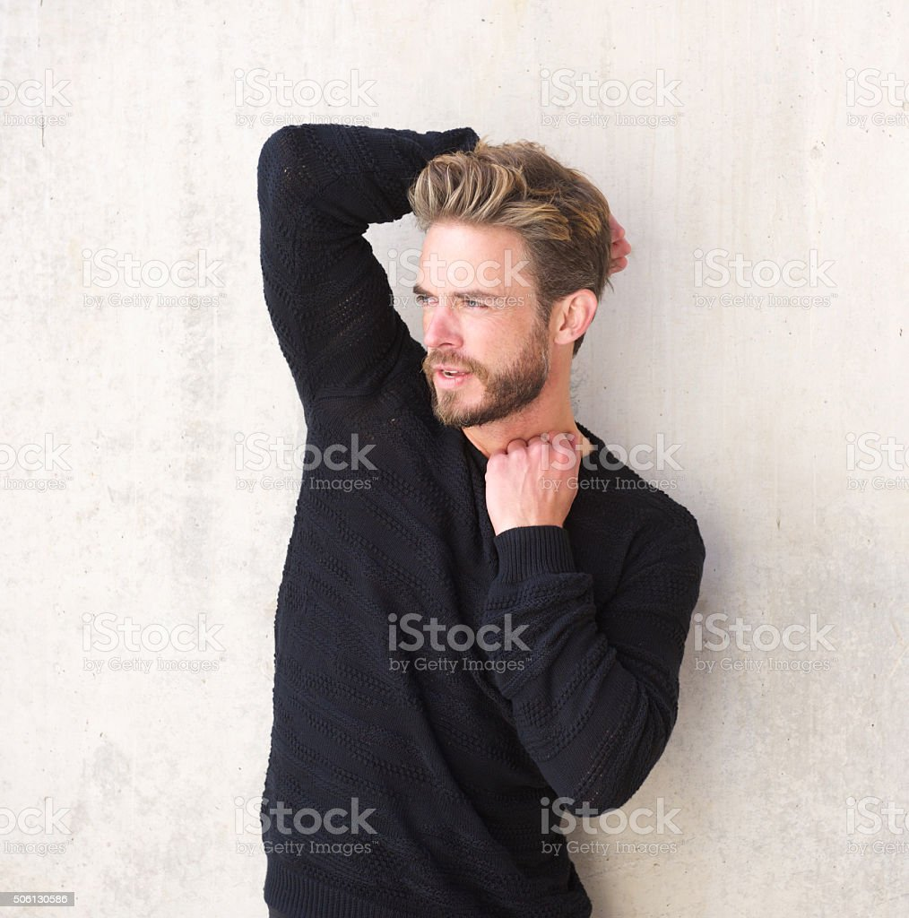 Handsome male fashion model with beard stock photo