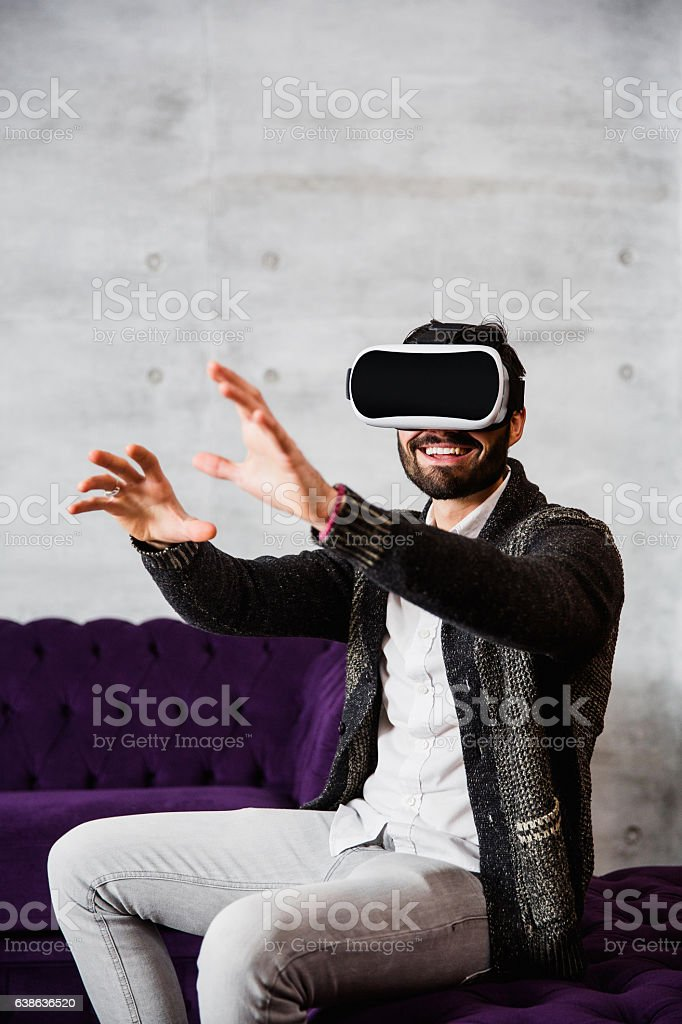 Handsome male in virtual reality stock photo