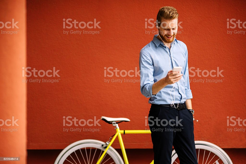 Handsome male listening music stock photo