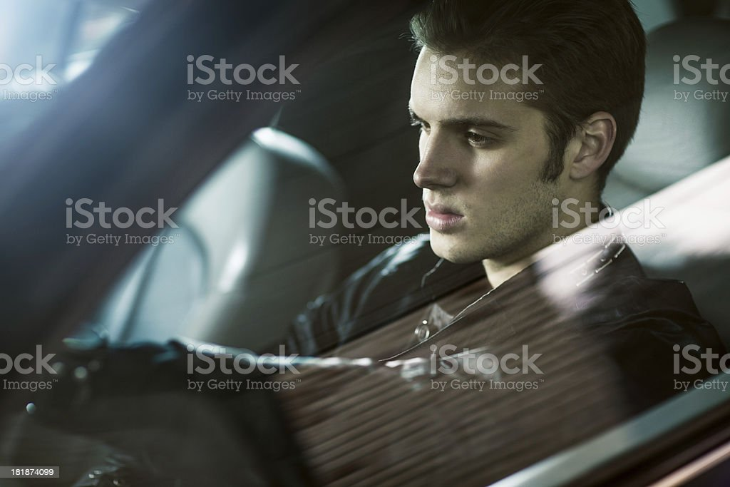 Handsome male model posing in car royalty-free stock photo