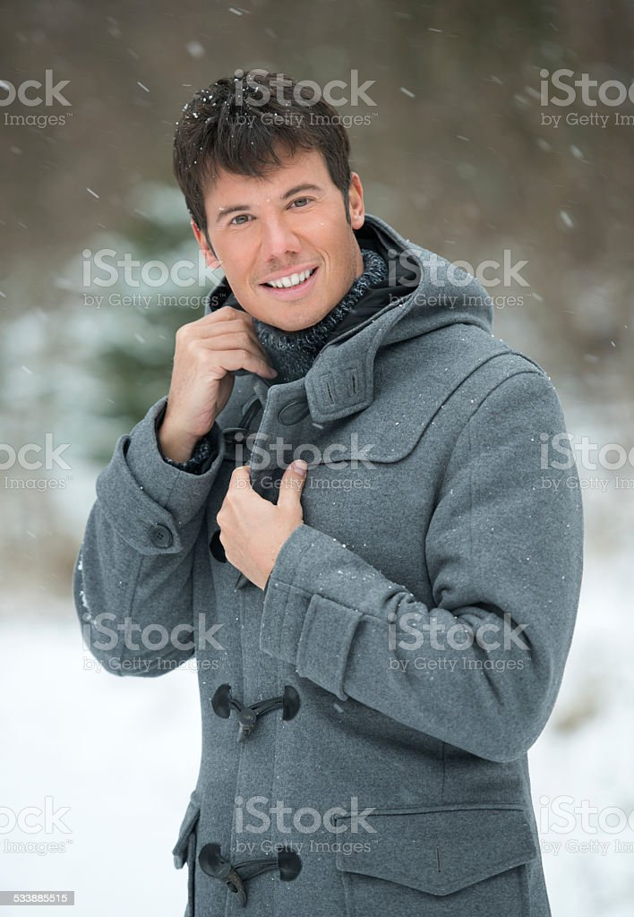 Handsome Male Winter Portrait in the Snow stock photo