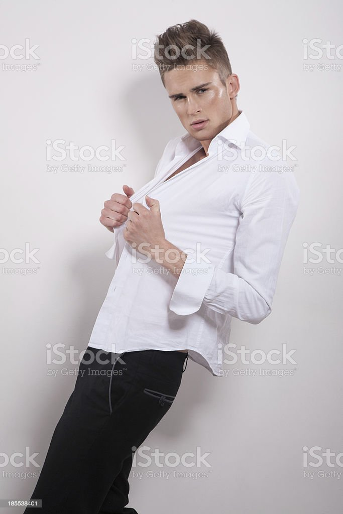 Handsome male with hands on his shirt looking at camera royalty-free stock photo