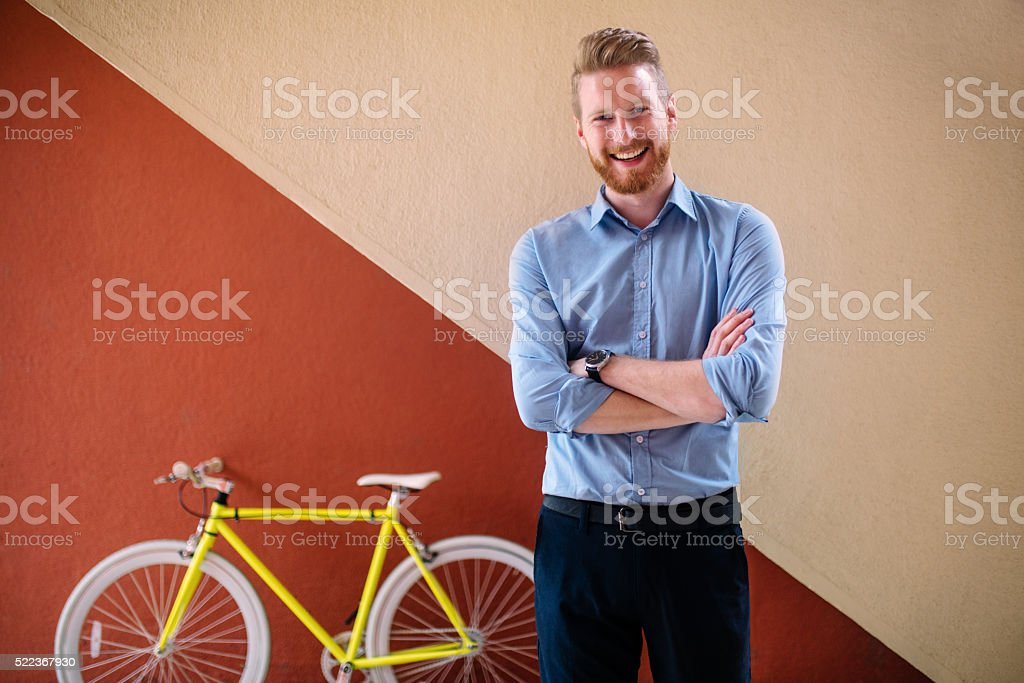 Handsome male with modern bicycle stock photo