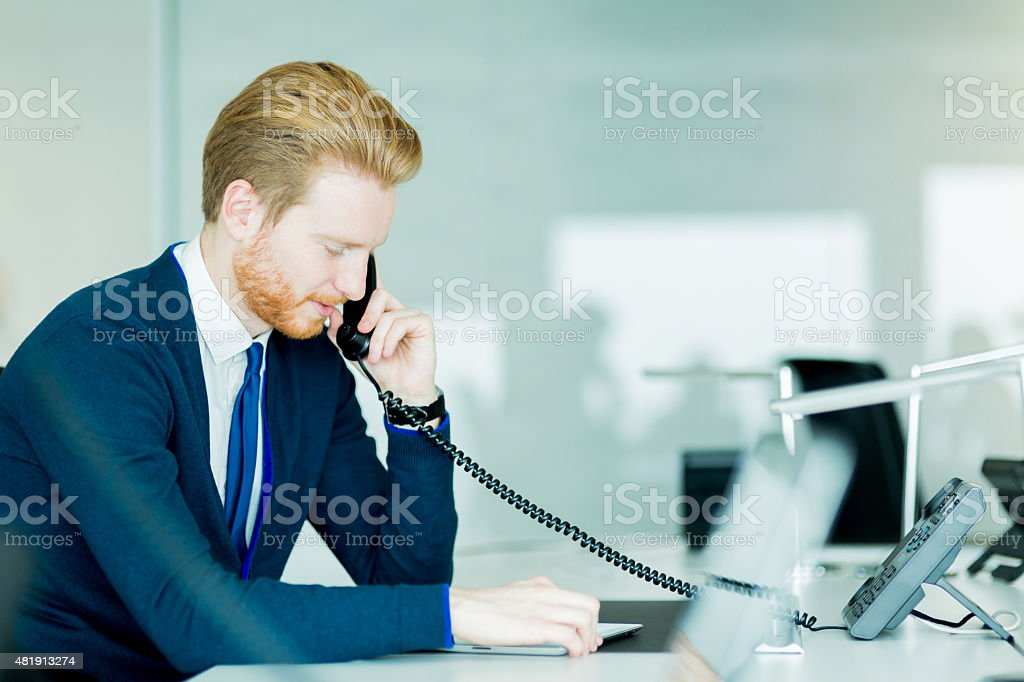 Handsome male worker in a call center office stock photo