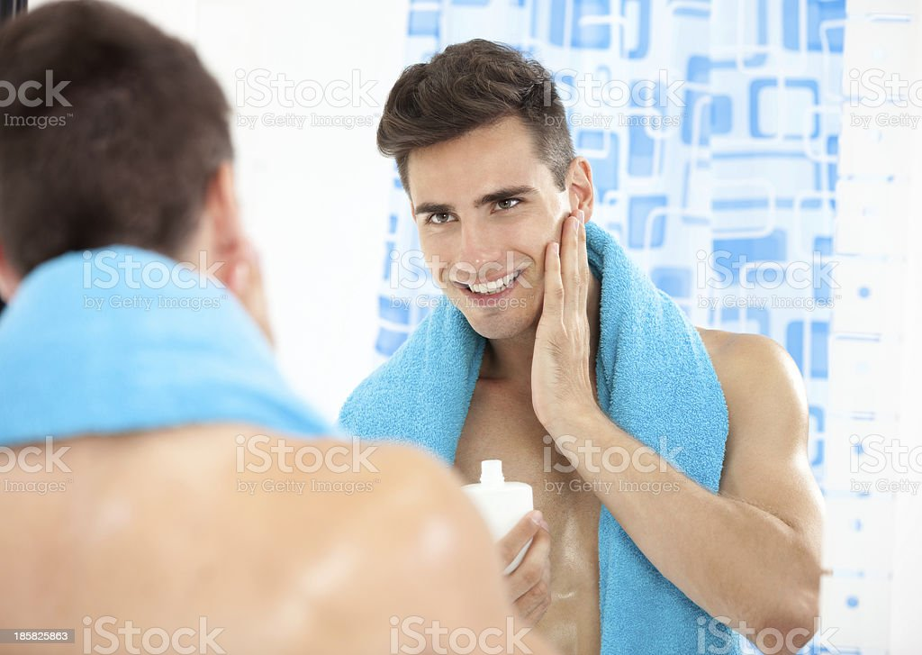 Handsome man after shave stock photo