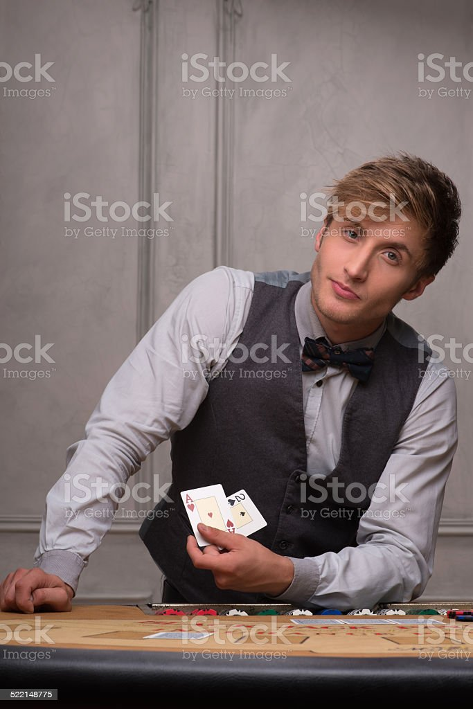 Handsome man and beautiful woman in casino stock photo