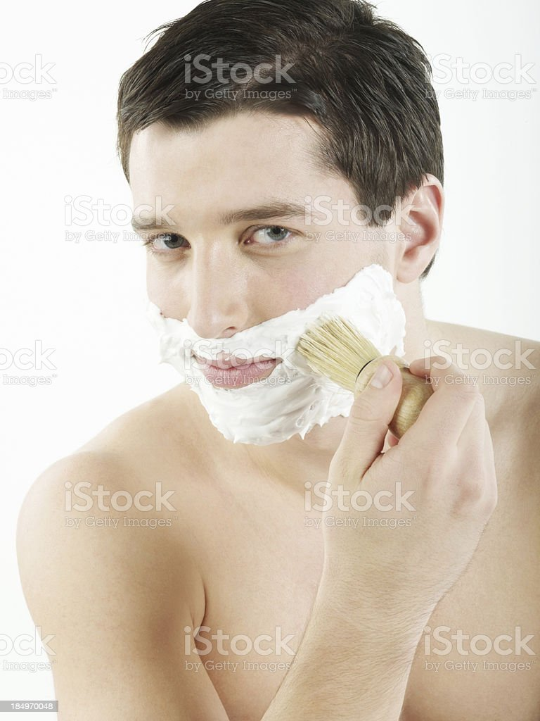 Handsome man applying shaving cream with brush royalty-free stock photo